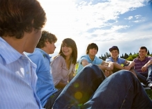 group of teens sitting together outside