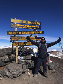 Sam Pasupalak at the peak of Mount Kilimanjaro