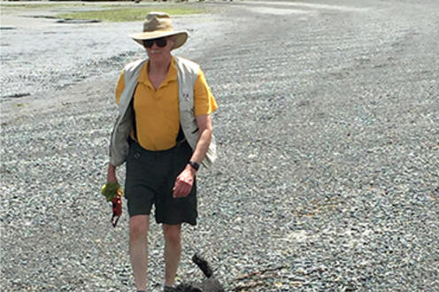John Beatty and his younger poodle Sparky walking on the beach at Gabriola Island