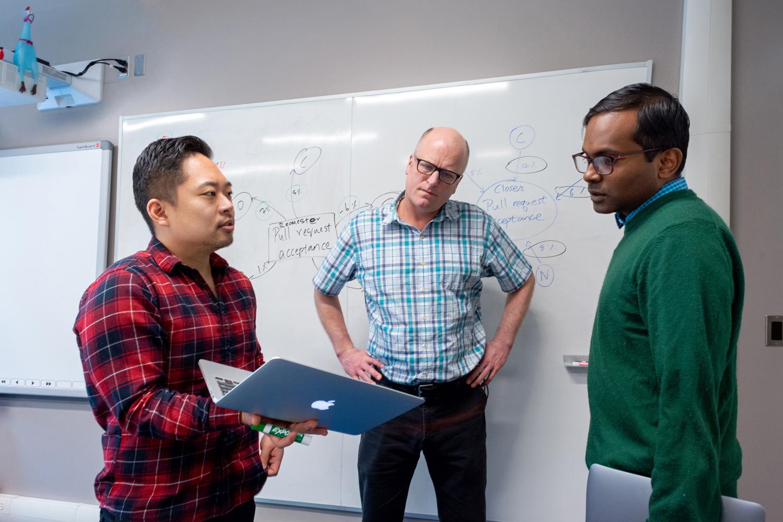 photo of Alex Yun and Professors Jesse Hoey and Meiyappan Nagappan