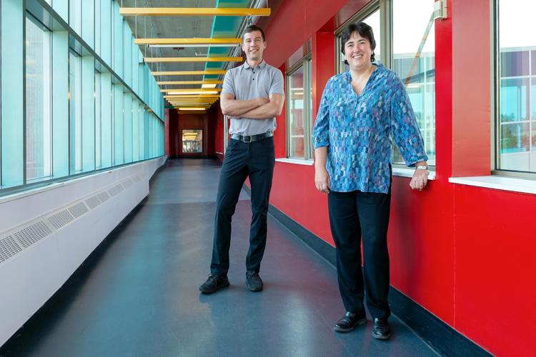 Photo of Fiodar Kazhamiaka and his co-supervisor Professor Catherine Rosenberg