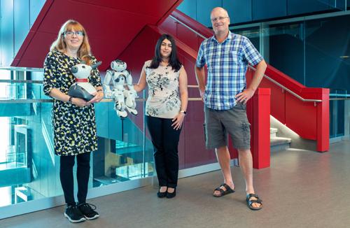 photo of Kerstin Dautenhahn, Moojan Ghafurian and Jesse Hoey with social robots