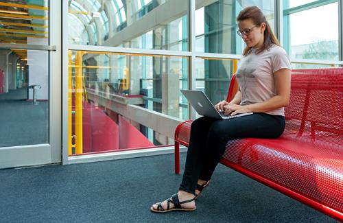 photo of Alexandra Vtyurina with laptop computer in Davis Centre