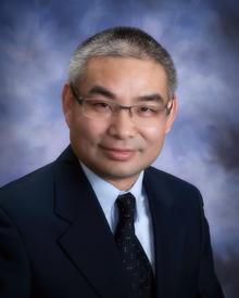 Professor Alan Huang