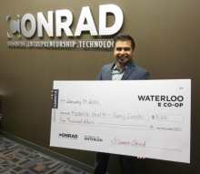 Harry Gandhi holds his $4,000 cheque for Medella Health