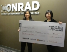 Victoria Suen and Carrie Cheng hold their $4,000 award for Rocket.