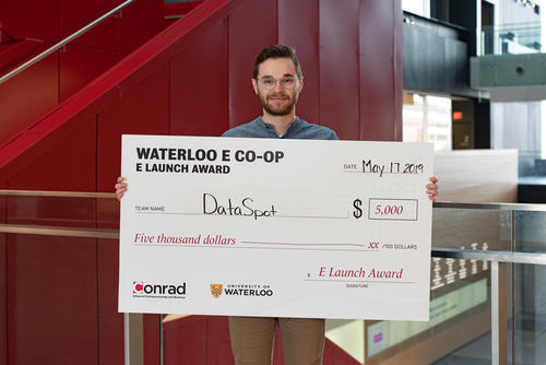 Daniel Hejnar with award cheque.