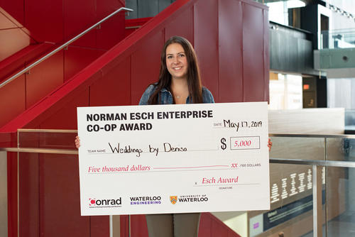 Denisa Suteu with award cheque.