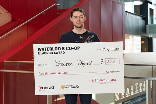 Patrick Stephen with award cheque.