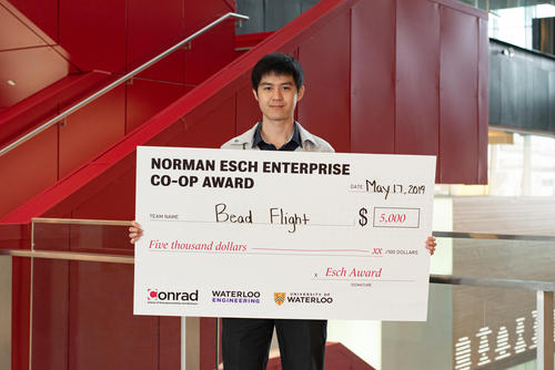 Terrence Chan with award cheque.