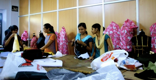 Indian women working with fabrics