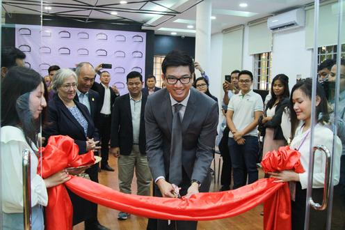 Richard Yim cutting red ribbon at Demine Robotics Cambodia grand opening
