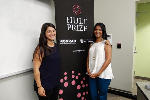Pragya Dawadi and Roopa Reddy with Hult Prize poster