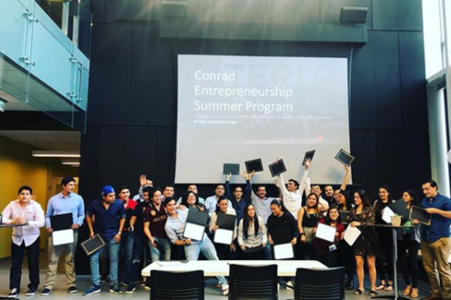 Students at pitch competition for the Conrad Summer Exchange Program
