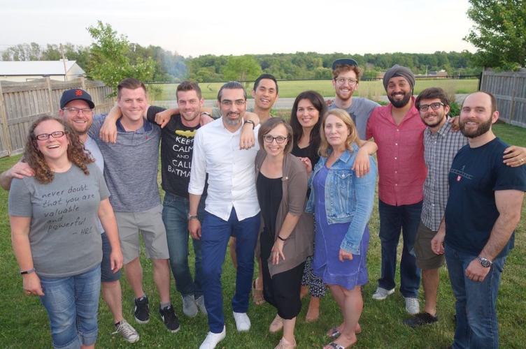 A large group of part-time MBET students at a backyard BBQ gathering.