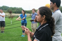 Students holding rope during group activity