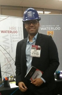 """Andrew Andrade at a """"Hire Waterloo Co-op"""" booth."""