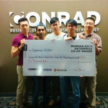 David Qian and team with cheque