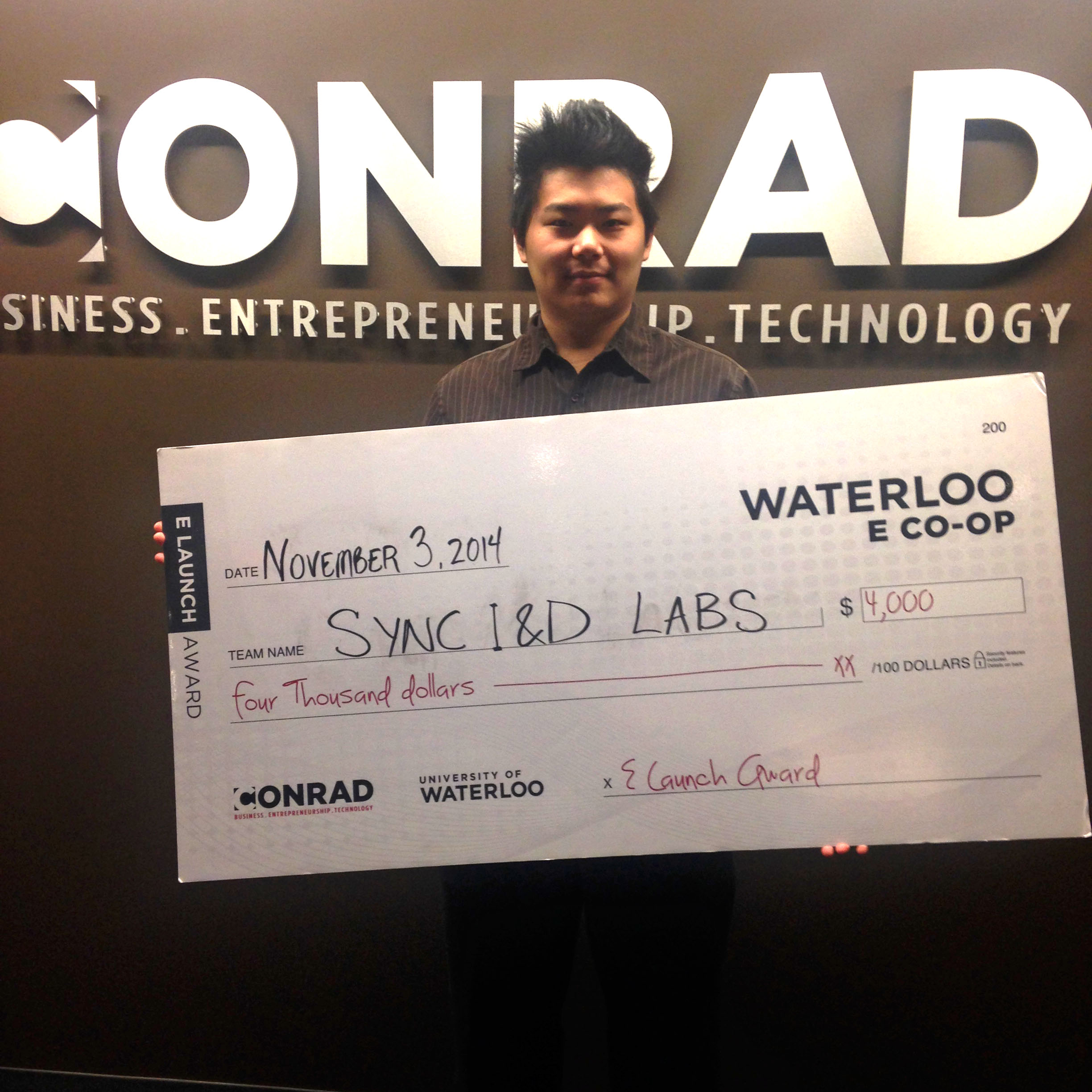 Cong Wang with Esch Award cheque