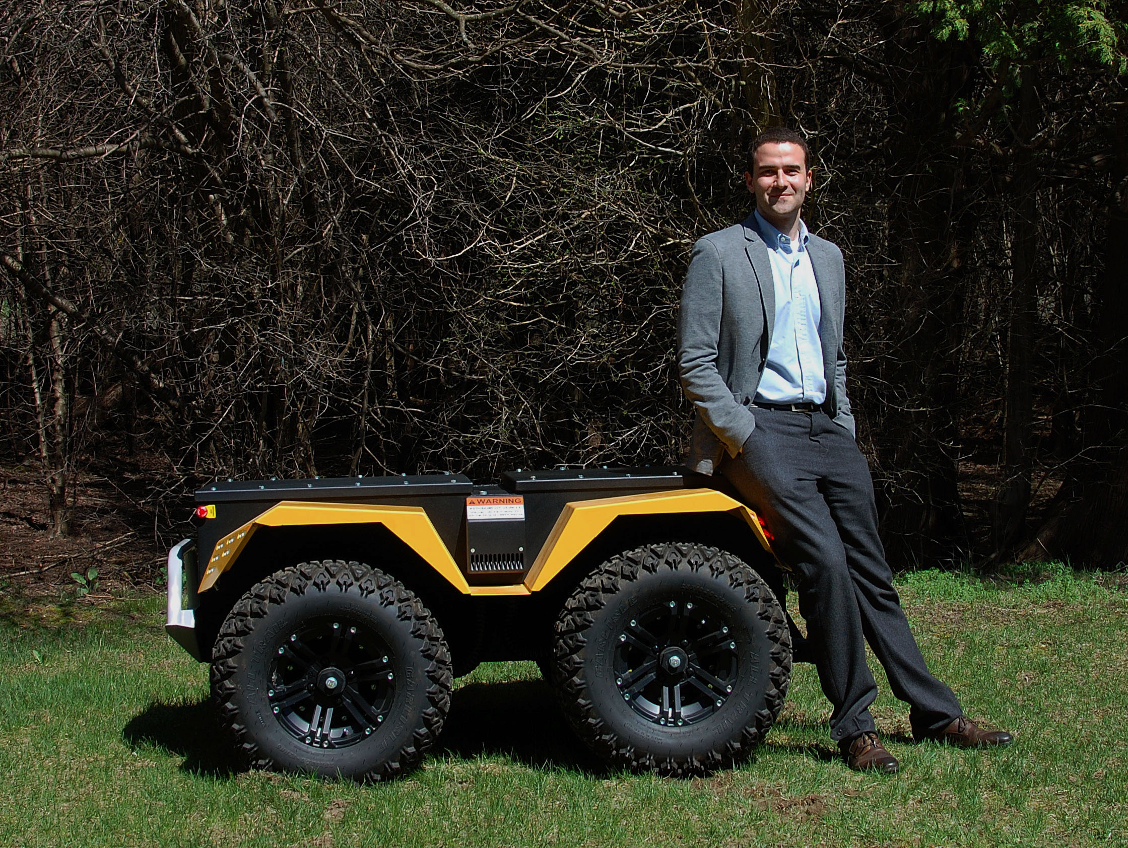 Matt Rendall, Clearpath Co-founder and CEO pictured with one of their robots.
