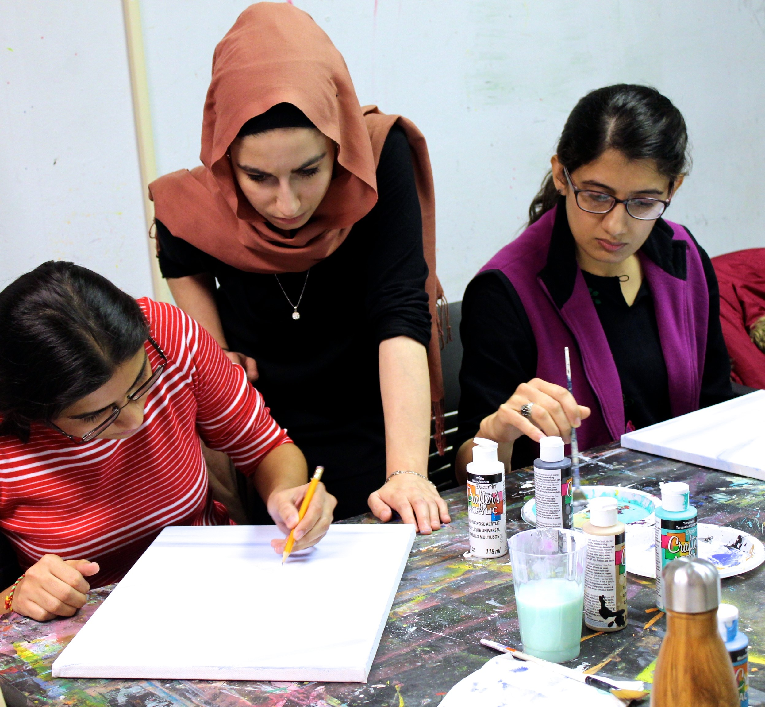 Medea Rasheed, E Co-op student, giving a painting workshop