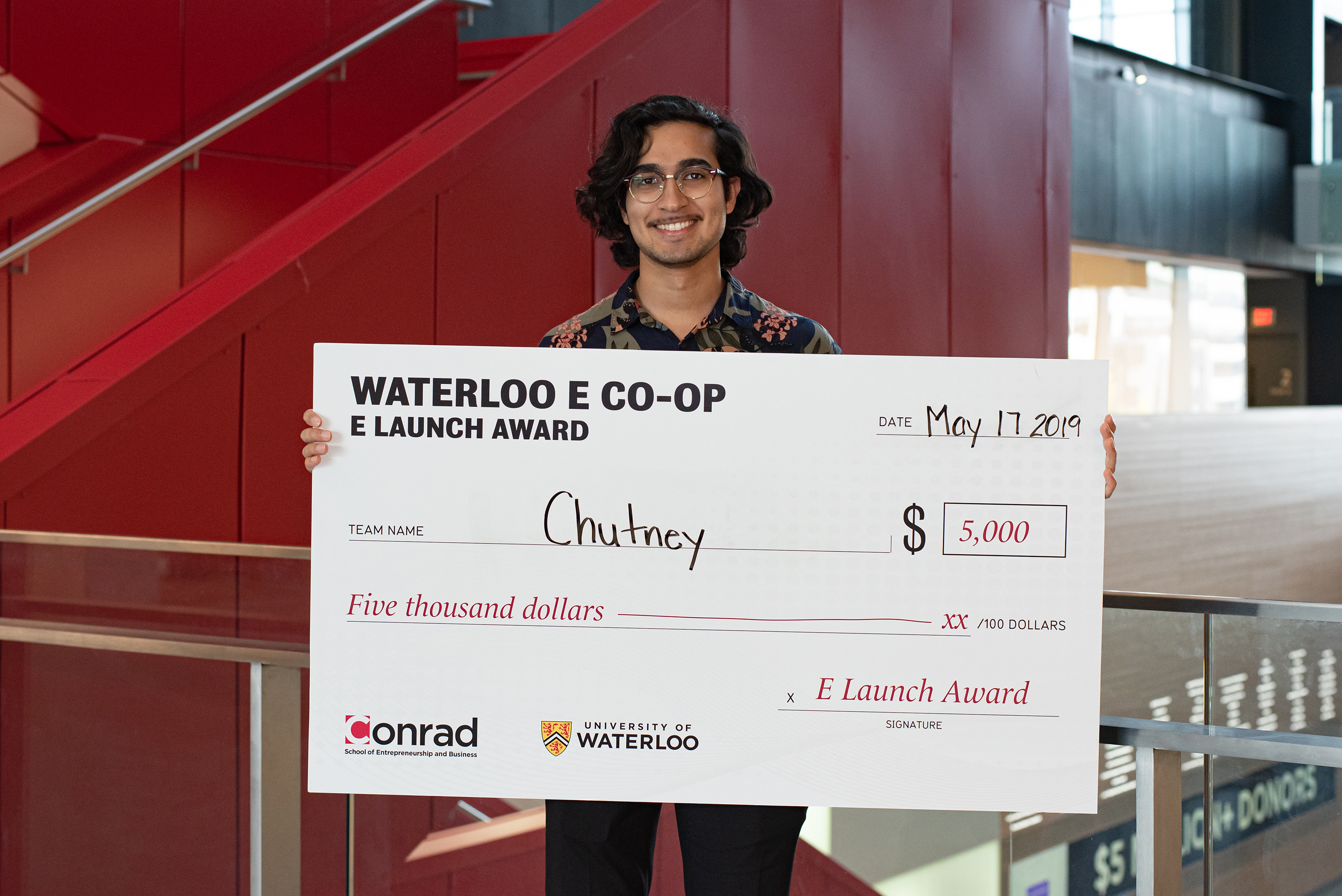 E Co-op award winner Osman Bari with award cheque.