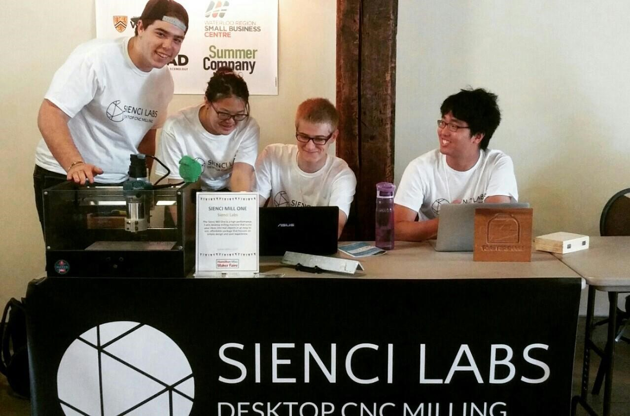 Sienci team at a maker faire booth