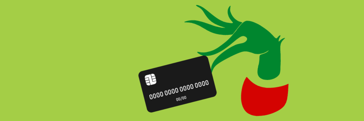 grinch hand holding credit card