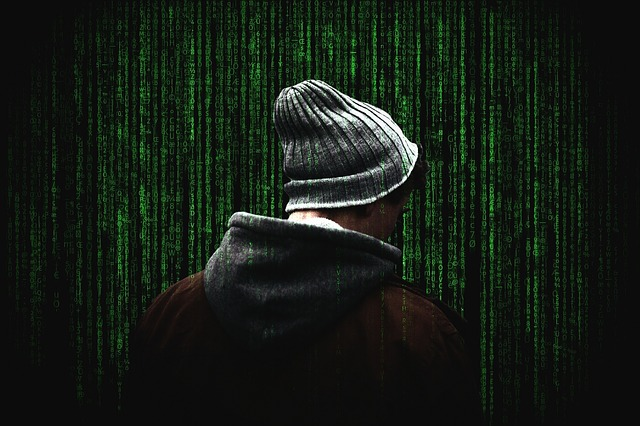 Photograph of a hacker from the back