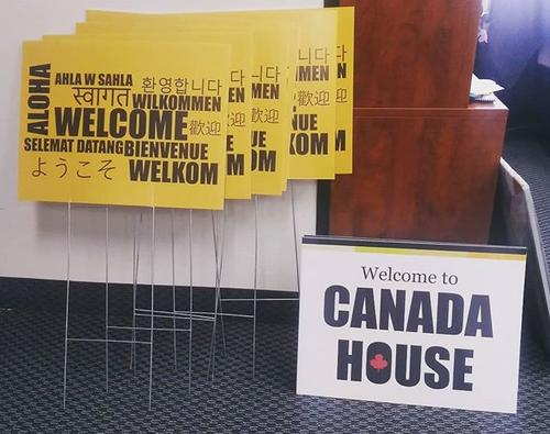 "A series of multilingual ""welcome"" and ""Canada House"" signs that will be placed around campus."