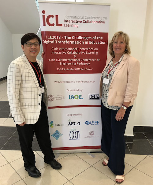 Director of Library Services Tony Tin and Professor Alice Schmidt Hanbidge with an academic integrity app banner at the IELA conference in Kos, Greece.