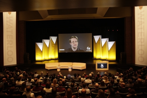 Edward Snowden speaks via remote link in the Humanities Theatre.