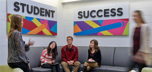 Students converse in the Student Success Office.