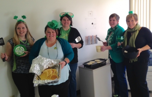 Angela Rooke, Carrie Nickerson, Patty Robinson-Angel, Julie MacMillan, Tasha Glover hold pancakes and utensils.