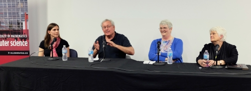 Panelists discussing the School of Computer Science's history.