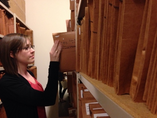 Meaghan McCracken files documents in the Symphony's archives.