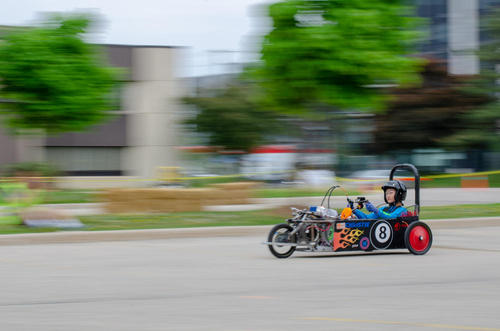 A student races an electric vehicle.