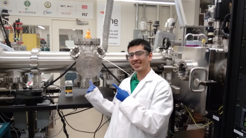 Jatin Patil in a lab next to a piece of equipment signed by President Barack Obama.