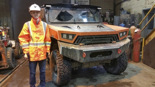 Matthew Gougeon stands next to the MineMaster Commander vehicle.