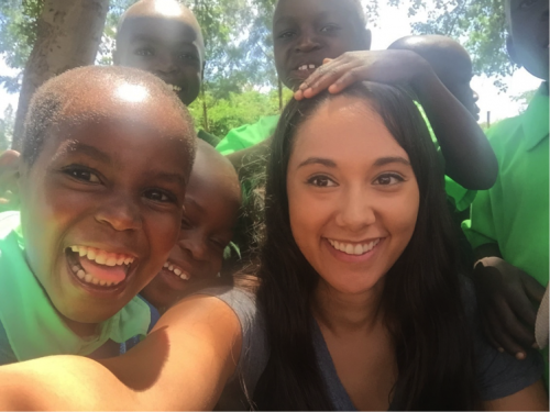Co-op student Rachel Zammit with a group of children.