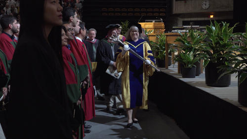 Professor Donna Strickland carries the mace at the Science Convocation ceremony on Thursday, June 13.
