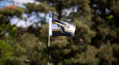 A Waterloo Warriors golf flag on the course.