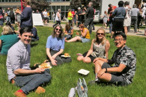 Employees sit on the grass at the Keystone Picnic.