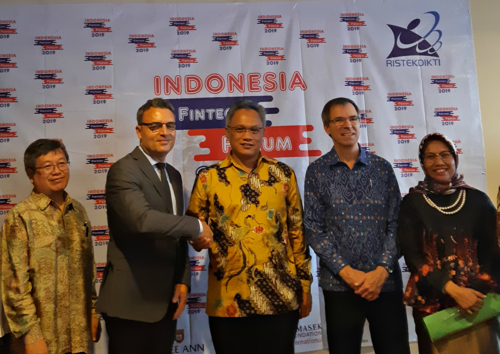 Representatives from Indonesia's education ministry, Global Affairs Canada and the READI project celebrate the launch of the Ministerial Decree.