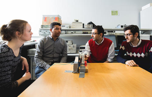 George Shaker (second from right) discusses research into the development of a glucose monitoring system for diabetics with students (left to right) Karly Smith, Ala Eldin Omer and Mostafa Alizadeh.