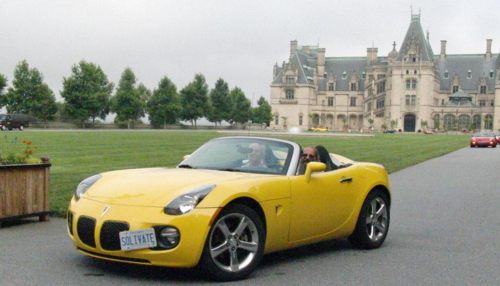 Allan Fleming behind the wheel of his Pontiac Solstice convertible.