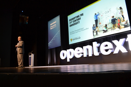 President Feridun Hamdullahpur speaks on stage at the Open Text Future Forward event.