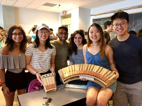 Engineering students with the accessible instrument they designed