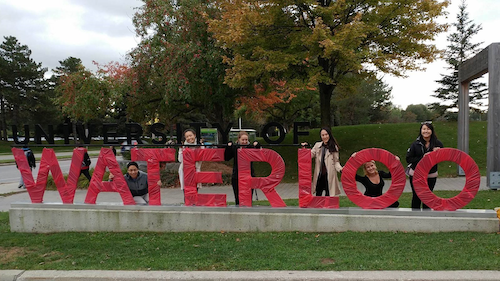 The University of Waterloo sign wrapped in red for the United Way campaign.