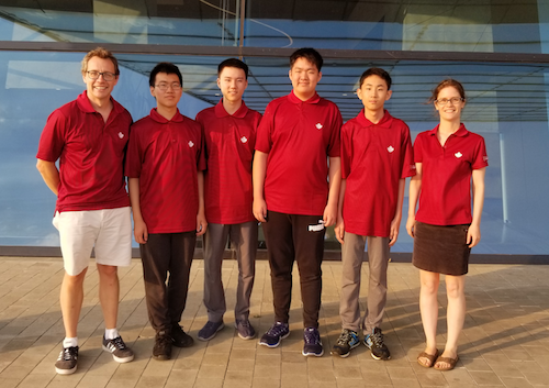 Informatics team members pose for a picture wearing red t-shirts.
